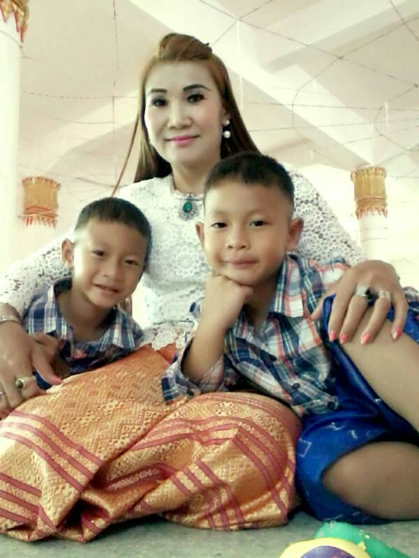 Kuhn Soo, a new believer in Thailand, with her two sons